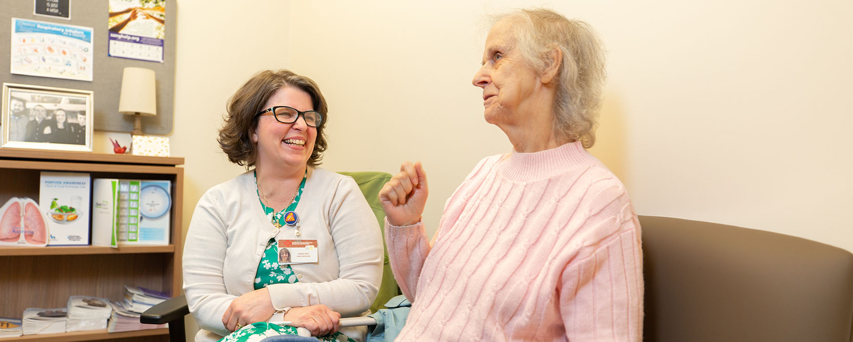 Older adult patient speaks with care manager