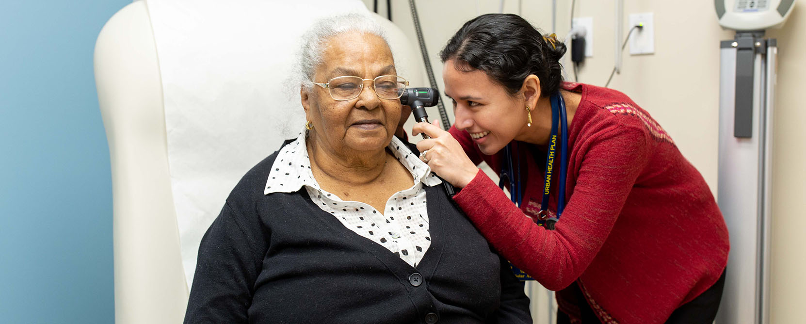 Older adult patient has her ears examined