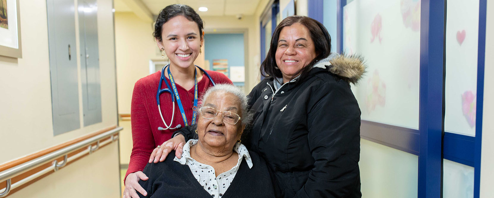 Patient poses with daughter and doctor