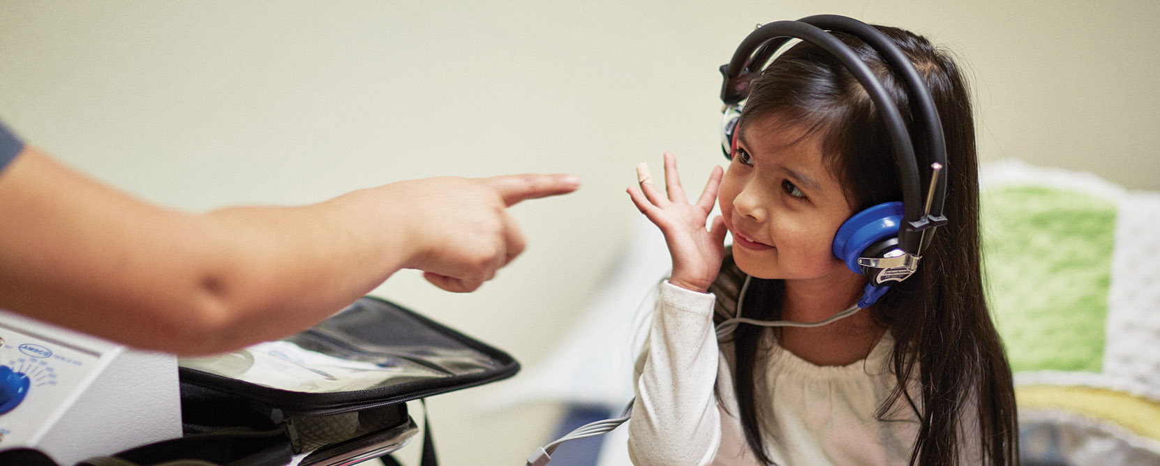 Small child receives a hearing test