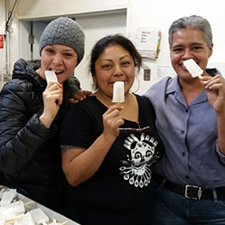 three cooperative workers pose with popsicles